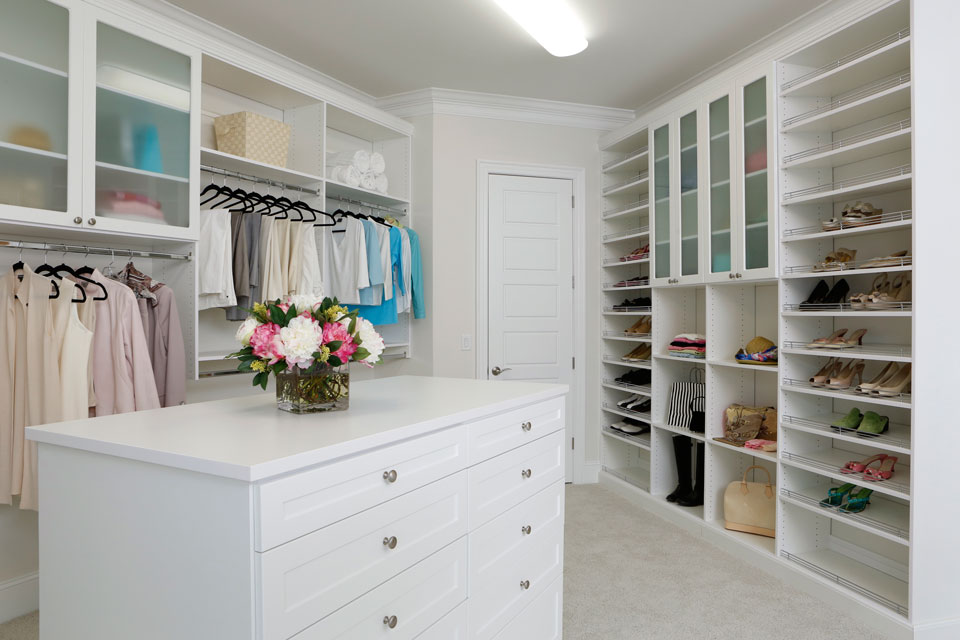 custom closet with island chest of drawers