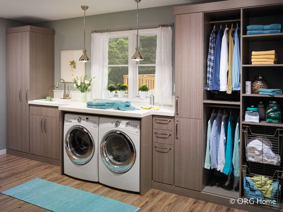 organized laundry room with Stricklands Home