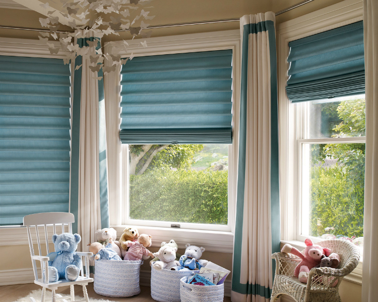 windows that are close together with a roman  shade treatment